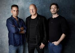 "Wade Robson, from left, director Dan Reed and James Safechuck pose for a portrait to promote the film ""Leaving Neverland"" during the Sundance Film Festival in Park City, Utah."