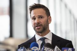 Former U.S. Rep. Aaron Schock speaks to reporters at the Dirksen Federal Courthouse