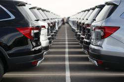 In this Nov. 28, 2018, file photo a long lines of unsold 2019 Pilot sports-utility vehicles sit at a Honda dealership in Highlands Ranch, Colo.