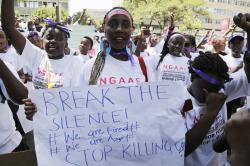 Kenyan people shout slogans during a march to mark International Women's Day in Nairobi, Kenya.