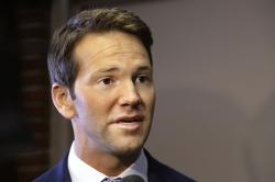 Former U.S. Rep. Aaron Schock speaks to reporters in Peoria, Ill.