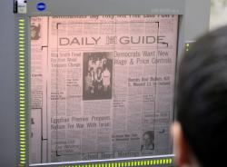 This Feb. 20, 2019 photo shows a microfilm copy of the Daily Guide at the library in Waynesville, Mo.