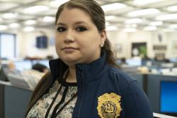 In this Feb. 11, 2019 photo, Rebecca Shutt, who works in the New York Police Department's Office of Crime Control Strategies, poses for a photo in New York