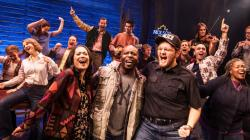 """A photo of the national company of """"Come From Away."""""""
