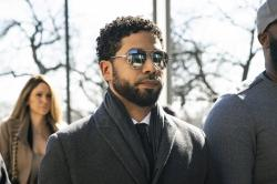 """Empire"" actor Jussie Smollett, center, arrives at Leighton Criminal Court Building."