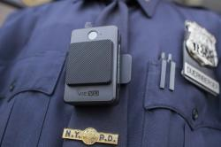 In this April 27, 2017 file photo, a police officer wears a newly-issued body camera outside in New York