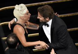 "Bradley Cooper, right, congratulates Lady Gaga in the audience after she is announced winner for best original song for ""Shallow"" from ""A Star Is Born"" at the Oscars."
