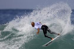 In this May 17, 2011, file photo, Kelly Slater competes in the first round of the Billabong Rio Pro surfing competition at the Arpoador Beach in Rio de Janeiro.