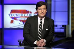 "In this March 2, 2017 file photo, Tucker Carlson, host of ""Tucker Carlson Tonight,"" poses for photos in a Fox News Channel studio, in New York. The liberal advocacy group Media Matters for America this week released two batches of recordings Carlson made as a guest on a radio show where he made denigrating remarks about race and gender."