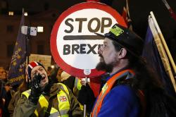 A pro-Brexit supporter, left, gestures at a remain supporter near the Parliament in London on Jan. 29, 2019. (Alastair Grant | Associated Press)