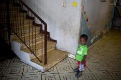 In this Thursday, June 28, 2018 file photo, a boy stands next to a staircase while looking out from the Nest of Hope orphanage in Port-au-Prince, Haiti.