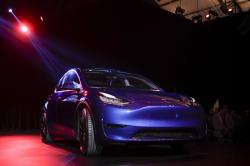 The Tesla Model Y is unveiled at Tesla's design studio Thursday, March 14, 2019, in Hawthorne, Calif.
