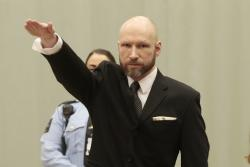 In this Tuesday, Jan. 10, 2017 file photo, Anders Behring Breivik raises his right hand at the start of his appeal case in Borgarting Court of Appeal at Telemark prison in Skien, Norway, Tuesday, Jan. 10, 2017.