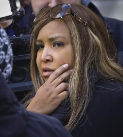 In this March 6, 2019 photo, HUD executive Lynne Patton, listens as a resident at the New York City Housing Authority's Queensbridge Houses in New York complains about conditions in her apartment.