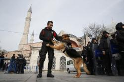 Backdropped by the Byzantine-era Hagia Sophia, Turkish police officers provide security during a protest against the mosque attacks in New Zealand in Istanbul, Saturday, March 16, 2019.
