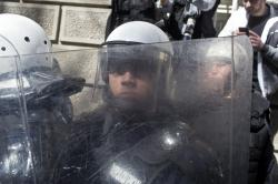 Riot police officers stand guard in front of the Serbian presidency building in Belgrade, Serbia, Sunday, March 17, 2019.