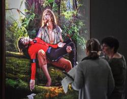 Visitors talk about the picture 'American Jesus: Hold me, carry me boldly' from US artist David LaChapelle at a preview of the exhibition 'Michael Jackson: On The Wall' at the Bundeskunsthalle museum in Bonn, Germany.