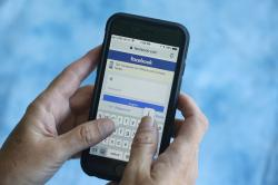 In this Aug. 21, 2018, file photo a Facebook start page is shown on a smartphone in Surfside, Fla. Facebook said Thursday, March 21, 2019, that it stored millions of its users' passwords in plain text for years