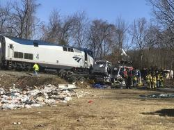 In this Wednesday, Jan. 31, 2018 file photo, emergency personnel work at the scene of a train crash involving a garbage truck struck by a train carrying Republican congressmen in Crozet, Va.
