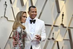 Jennifer Lopez, left, and Alex Rodriguez arrive at the Oscars.