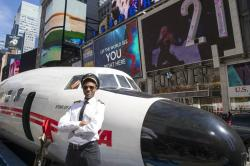 "A Lockheed Constellation L-1649A Starliner, known as the ""Connie, is parked in New York's Times Square during a promotional event."