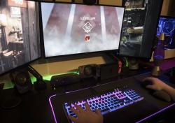"""This Wednesday, March 6, 2019, photo shows a """"Level up!"""" screen as a gamer plays """"Apex Legends"""" in Jersey City, N.J."""