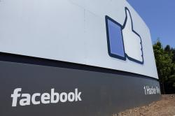 This July 16, 2013 file photo shows a sign at Facebook headquarters in Menlo Park, Calif.