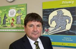 This March 17, 2014, photo, shows New Zealand Privacy Commissioner John Edwards at his office in Wellington, New Zealand