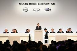 In this photo released by Nissan Motor Co., Nissan Chief Executive Hiroto Saikawa, center, speaks at the company's shareholders' meeting in Tokyo Monday, April 8, 2019