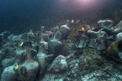 In this photo taken on Sunday, April 7, 2019, ancient amphoras lie at the bottom of the sea from a 5th Century B.C. shipwreck, the first ancient shipwreck to be opened to the public in Greece, including to recreational divers who will be able to visit the wreck itself, near the coast of Peristera, Greece
