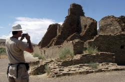 In this Aug. 10, 2005, file photo, tourist Chris Farthing from Suffolks County, England, takes a picture while visiting Chaco Culture National Historical Park in northwestern New Mexico