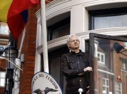 In this Friday, May 19, 2017 file photo, Julian Assange greets supporters outside the Ecuadorian embassy in London