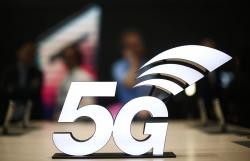 This Feb. 25, 2019 file photo shows a banner of the 5G network is displayed during the Mobile World Congress wireless show, in Barcelona, Spain