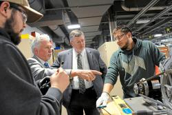 In this Tuesday, April 10, 2018, file photo, Ken Broadbent, second from left, business manager of the Pittsburgh Steamfitters Local 449, gives a tour at the new Steamfitters Local Union 449 Technology Center in Harmony, Pa.