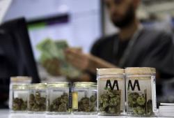 In this July 1, 2017, file photo, a cashier rings up a marijuana sale at the Essence cannabis dispensary in Las Vegas