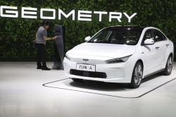 Chinese automaker Geely Auto displays a sedan from its new electric brand Geometry during the Auto Shanghai 2019 show in Shanghai Tuesday, April 16, 2019