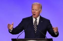 In this April 5, 2019, file photo, former Vice President Joe Biden speaks at the International Brotherhood of Electrical Workers construction and maintenance conference in Washington