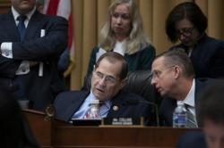 House Judiciary Committee Chair Jerrold Nadler, D-N.Y., joined at right by Ranking Member Doug Collins, R-Ga., confer before a resolution was passed to subpoena special counsel Robert Mueller's full report, on Capitol Hill in Washington, Wednesday, April 3, 2019