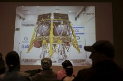 People watch the live broadcast of the SpaceIL spacecraft as it lost contact with Earth in Netanya, Israel, Thursday, April 11, 2019