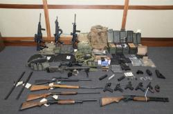 This image provided by the U.S. District Court in Maryland shows a photo of firearms and ammunition that was in the motion for detention pending trial in the case against Christopher Paul Hasson
