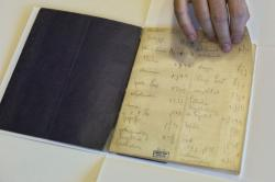In this file photo taken on Oct. 5, 2014, a library official shows celebrated author Franz Kafka's Hebrew vocabulary notebook at Israel's National Library in Jerusalem