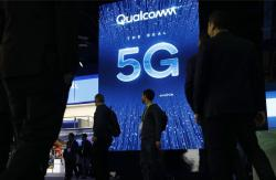 In this Jan. 9, 2019, file photo a sign advertises 5G at the Qualcomm booth at CES International in Las Vegas