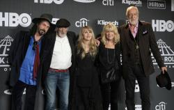 Stevie Nicks, center, posing with other members of Fleetwood Mac, from left, Mike Campbell, John McVie, Christine McVie and Mick Fleetwood at the Rock & Roll Hall of Fame induction ceremony in New York.