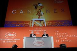 Festival director Thierry Fremaux, left, and festival president Pierre Lescure in front of the Cannes International Film Festival poster for the upcoming 72nd edition during a press conference to announce this years line up in Paris.