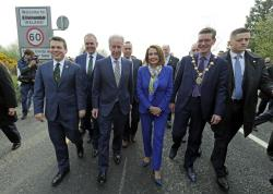 Delegates, from left, U.S. Congressman Brendan Boyle, Irish Education Minister Joe McHugh, U.S. Congressman Richard Neal and US House of Representatives speaker Nancy Pelosi, cross the Irish border from Northern Ireland into the Republic of Ireland.