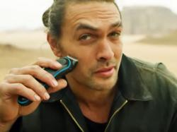 Jason Momoa shaves his beard in a YouTube video.