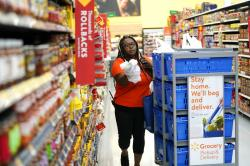 Walmart associate Alicia Carter fulfills online grocery orders at a Walmart Supercenter in Houston.