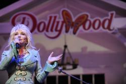 In this Aug. 21, 2013 file photo, Dolly Parton speaks during a news conference in Pigeon Forge, Tenn.