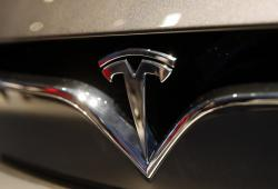 This Oct. 3, 2018, file photo shows a Tesla emblem at the Auto show in Paris
