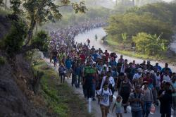 Central American migrants, part of a caravan hoping to reach the U.S. border, move on the road in Escuintla, Chiapas State, Mexico, Saturday, April 20, 2019
